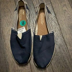 Navy and white Toms